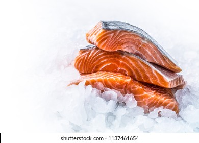 Close-up Fresh raw salmon fillets on Ice.
