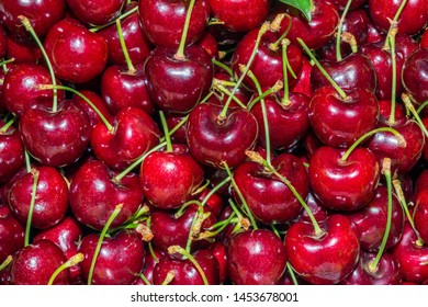 Closeup of fresh red cherry background.