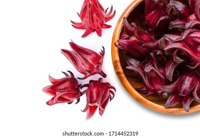 Close-up fresh red  Roselle fruit ( Jamaica sorrel, Rozelle or hibiscus sabdariffa ) in wooden bowl isolated on white background. Top view. Flat lay.
