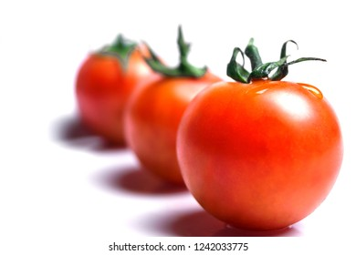 Close-up of fresh Red Tomatoes isolated on white Background.