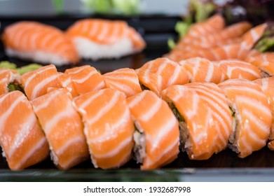 Close-up of fresh rolls and sushi set. Japanese cuisine. Tasty food. Fish and rice.