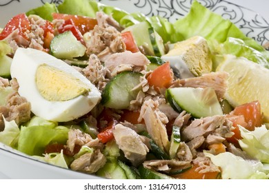Closeup of fresh salad with tuna, eggs and vegetables