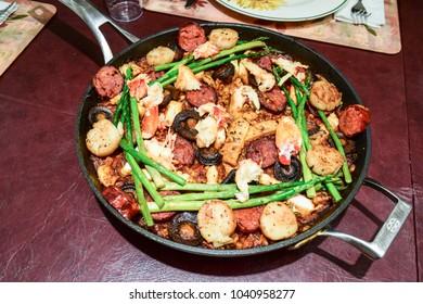Closeup of fresh seafood and sausage Spanish paella