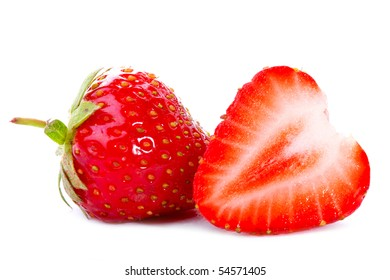 Close-up of fresh strawberry with slice isolated on white