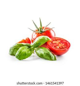Close-up fresh tomato with basil isolated on fhite background.