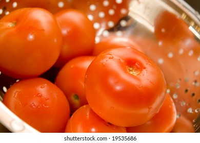 Close-up of fresh tomatos in silver strainer