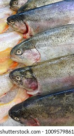 Close-up of fresh trout fish for sale in market