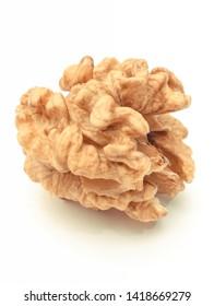 Closeup of fresh walnut without shell on white background