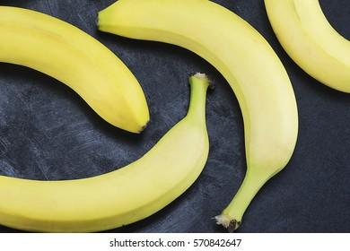 Closeup of fresh yellow bananas, top view