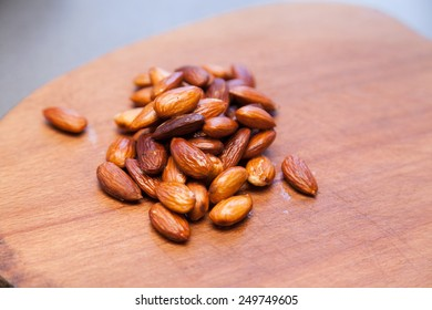Closeup of freshly roasted almonds with selective focus