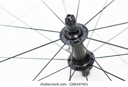 Closeup of front bicycle wheel, hub and spokes of road bike