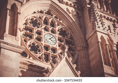 A close-up of the front clock of the Notre-Dame Church, in Cholet.