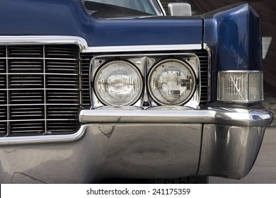 Closeup of the front and headlights of an american classic car.