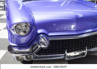 Close-up of front right side of a blue vintage car vintage car