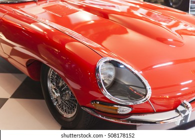 Close-up of front right side of a red vintage car