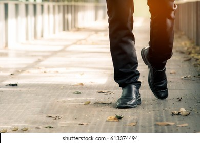 Close-up of front view business man elegant shoes walking