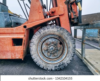 Close-up Front Wheel of Old Forklift Truck