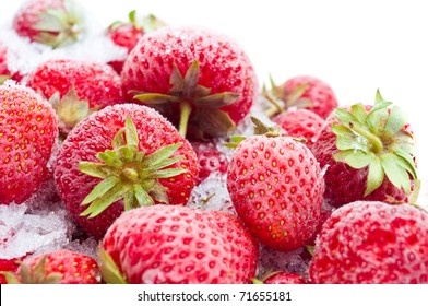 Closeup of frozen strawberries isolated on white