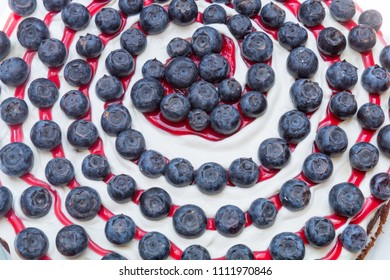 closeup of a fruit flan with creamy curd and spiral formed blueberry topping