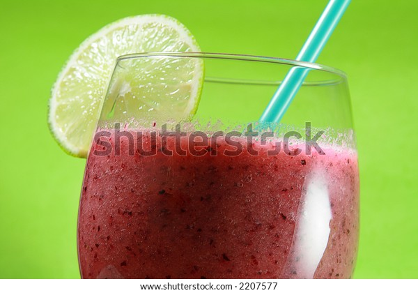 Close-up Fruit Juice with Lime and Straw