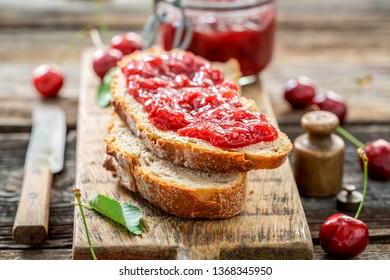 Closeup of fruity sandwich with fresh cherry jam
