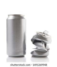 Closeup of a full aluminum can and one crushed empty can. Cans have no label.