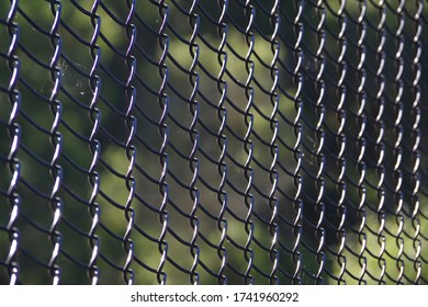 Close-up full frame view of a section of a black colored chainlink fence