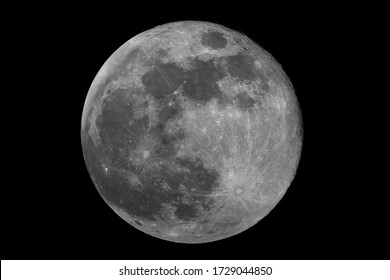 Closeup to the full phase super Moon, isolated in the black space, with no star and some creaters in detail.
