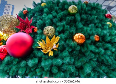 Close-up, full-frame view of Artificial Christmas tree decoration at the shopping mall in Singapore. Christmas background/texture. Colourful and holiday�s concept