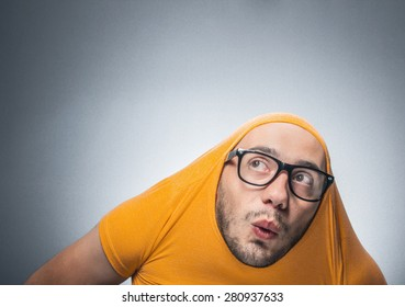 Close-up of a funny man isolated on gray background with copy space. Crazy guy looking up