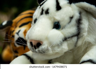 Closeup funny orange and black&white striped begal tiger dolls.
