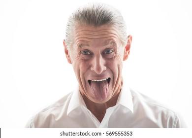 Closeup of Funny Senior Man Showing Tongue