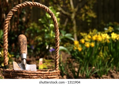 Close-up of a gardening basket containing a trowel