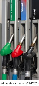 Closeup of Gas Pump Nozzles at Gas Station