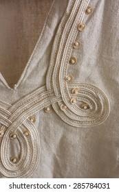 Closeup of gauzy linen tunics finish/ Finish linen tunics