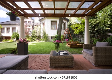 Close-up of gazebo with stylish garden furniture