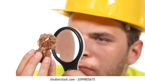 Closeup of Gemologist Engineer Man Examine Satin Spar Form Mineral with Magnifying Glass, Gemmology or Mineralogy Study Concept