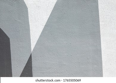 Closeup of geometric gray urban wall texture. Modern pattern for wallpaper design. Creative urban city background. Abstract open composition. Minimal geometric style, solid colors