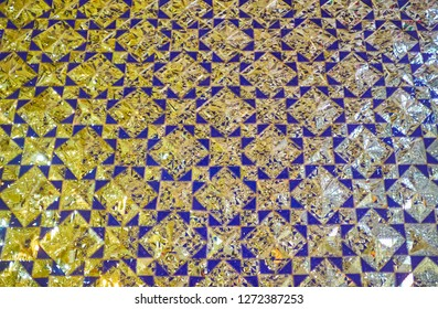 The close-up of the geometric mirror pattern on the wall of Imam zadeh Jafar Shrine, Yazd, Iran.