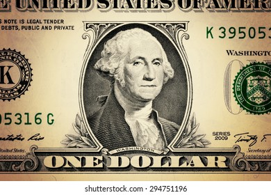 closeup George Washington face on the US $1 dollar bill.