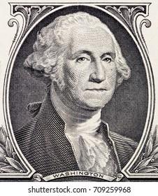 Close-up of George Washington portrait on one dollar bill. United States money, macro