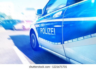 close-up of German police car with flashing blue light on street