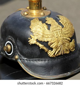 """Closeup of a German WW1 Pickelhaube showing the emblem and motto """"MIT GOTT FUER KOENIG UND VATERLAND"""" (With God For King And Fatherland)"""