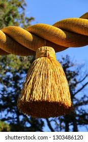 A close-up of giant tassel in shimenawa, sacred rice straw rope used for purification and protection from evil in Japanese traditional religion Shinto