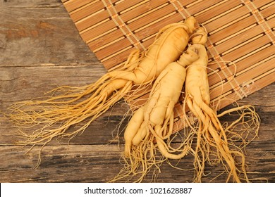 Close-up of ginseng roots on a wooden surface