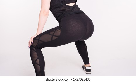Close-up of girl dancing twerk in the dance class on white background
