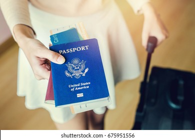 Closeup of girl holding passports and boarding pass