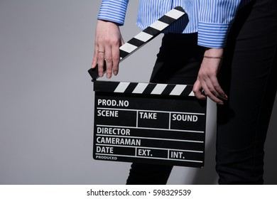 Close-up of a girl with movie clapper.