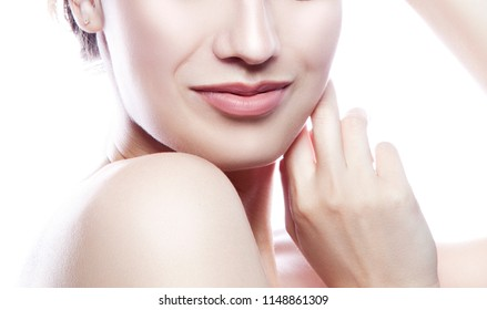 Close-up girl part of face with smile. Hands near clean skin. White background