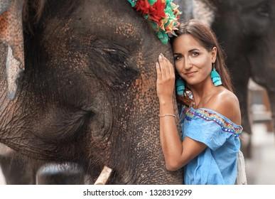 close-up of the girl who hugs the elephant's head.